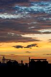Rice mill. Against many cloud sunset sky stock images