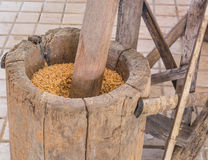 Rice mill. Thai style hammer of rice mill made from wood stock photo
