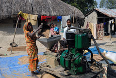 Rice Mill. Villagers busy at the rice mill in the homely atmosphere stock photo