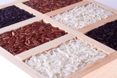 Rice mix  in wood plate. In close up royalty free stock photo