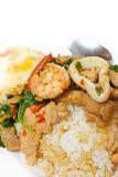 Rice and mixed seafood basil and fried egg. Royalty Free Stock Photo