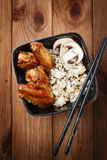 Rice with mushrooms and baked chicken wings Royalty Free Stock Image