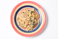 Rice with mushrooms and kohlrabi. In a striped plate in the kitchen Stock Photo