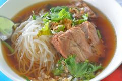 Rice noodle in Chinese traditional medicine Soup with Stew Pork Stock Photo