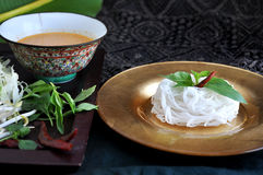 Rice Noodle on Golden Plate with Spicy Sauce Royalty Free Stock Image