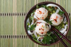Rice noodle soup with fish balls top view Stock Photo