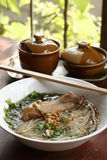 Rice noodle soup with stewed chicken and chinese herbs Stock Photography