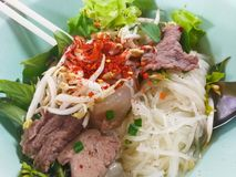Rice noodle soup with Stewed pork. And fresh vegetables Cayenne pepper Royalty Free Stock Images