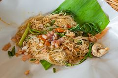 Rice noodle stir fry vegetables on the banana leaves. royalty free stock photography