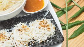Rice noodle stream with vegetable soup and sukiyaki chilli sauce stock image