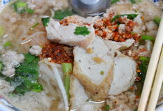 Rice noodle topping fish line and pork dressing cayenne pepper. In bowl Royalty Free Stock Photography