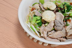 Rice noodle topping pork ball and boiled slice pork Stock Photography