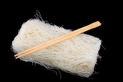 Rice noodles. Asian dried rice noodles on black background Stock Images