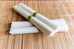 Rice noodles on bamboo napkin Stock Images