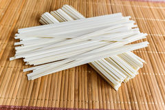 Rice noodles on bamboo napkin Royalty Free Stock Photography