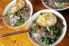 Rice noodles with beef fried eggs Stock Photos