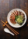 Rice noodles bowl with Peking Duck Stock Image