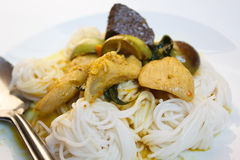 Rice noodles with chicken green curry. Stock Photos