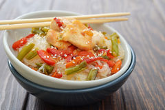 Rice noodles with chicken. And vegetables in bowl closeup Royalty Free Stock Photos