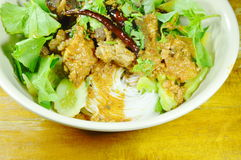 Rice noodles dressing spicy chop pork and bone red cotton tree sauce with vegetable on bowl Royalty Free Stock Images