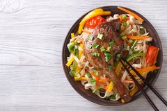 Rice noodles with duck leg and vegetables horizontal, top view Stock Images