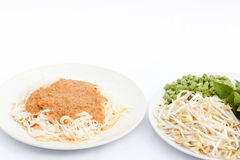 Rice noodles in fish curry sauce and vegetables. Rice noodles in fish curry sauce and vegetables,traditional food of Thai people Royalty Free Stock Images