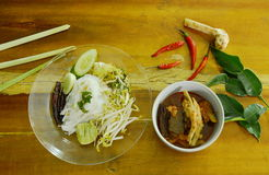 rice noodles and fresh vegetable with spicy chicken feet red cotton tree sauce Royalty Free Stock Photography