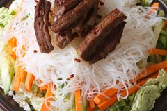 Rice noodles with meat and vegetables macro horizontal Stock Photo