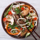Rice noodles with mushrooms , meat, vegetables close-up top view Stock Photography