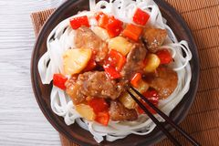 Rice noodles with pork meat in sweet and sour sauce  top view Royalty Free Stock Image
