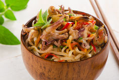 Rice noodles with seafood closeup in wooden bowl. Stock Photo