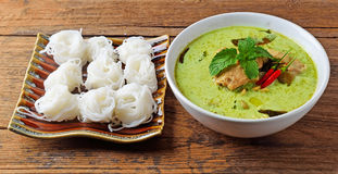 Rice noodles served with Chicken Green Curry. Stock Photo