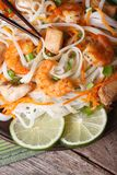 Rice noodles with shrimp and chicken, vegetables vertical Royalty Free Stock Photo