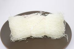 Rice noodles. Some uncooked asian rice noodles Stock Photography