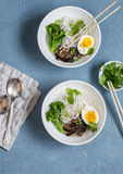 Rice noodles soup with broccoli, mushrooms and boiled egg. Healthy vegetarian food Stock Photos