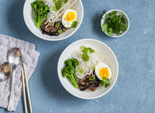 Rice noodles soup with broccoli, mushrooms and boiled egg. Healthy vegetarian food Royalty Free Stock Image