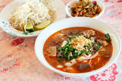 Rice noodles with spicy pork sauce (Nam ngiao). Thai Food. Rice noodles with spicy pork sauce (Nam ngiao) is a noodle soup or curry of the cuisine of the Tai Stock Image