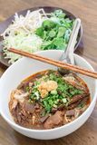 Rice noodles with spicy pork sauce (Nam ngiao) is a noodle soup Royalty Free Stock Images