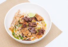 Rice noodles with spicy pork sauce Royalty Free Stock Images