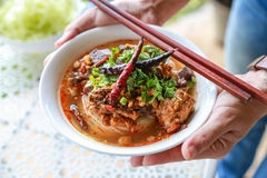 Rice noodles with spicy pork sauce. Thai food Royalty Free Stock Images