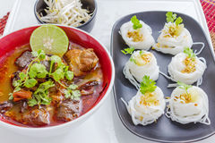 Rice noodles with spicy pork sauce Stock Image