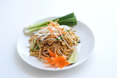 Crispy Chicken Pad Thai. Rice noodles stir-fried with egg, scallions, bean sprouts and ground peanuts topped with crispy chicken royalty free stock photos