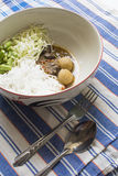 Rice noodles with Thai spicy soup. And some vegetable stock image