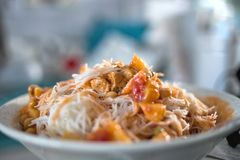 Rice noodles topped with sauce made from chili. White pasta in plate with nice vivid colors Stock Photography