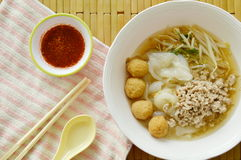Rice noodles topping boiled minced pork and shrimp ball in soup with chili sauce Stock Photo