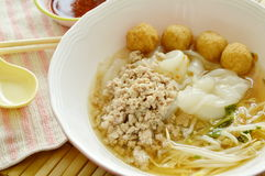Rice noodles topping boiled minced pork and shrimp ball in soup with chili sauce Royalty Free Stock Photos