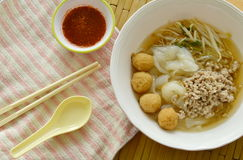 Rice noodles topping boiled minced pork and shrimp ball in soup with chili sauce Stock Images