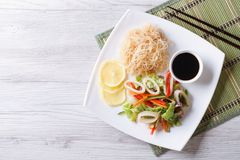 Rice noodles and vegetable salad with squid horizontal top view Royalty Free Stock Photography