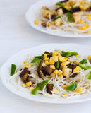 Rice noodles with vegetables. On a plate Stock Photos