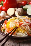 Rice noodles with vegetables and ingredients. Vertical Royalty Free Stock Images